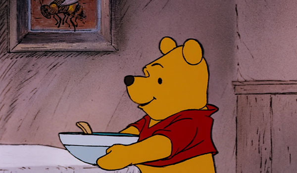 Pooh gets out a bowl and spoon in preparation for his meal. Yet throughout the whole film, he always eats honey directly out of the pot (or the tree).