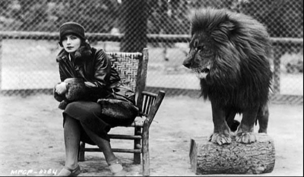 Garbo in a publicity shot with MGM's Leo the Lion.