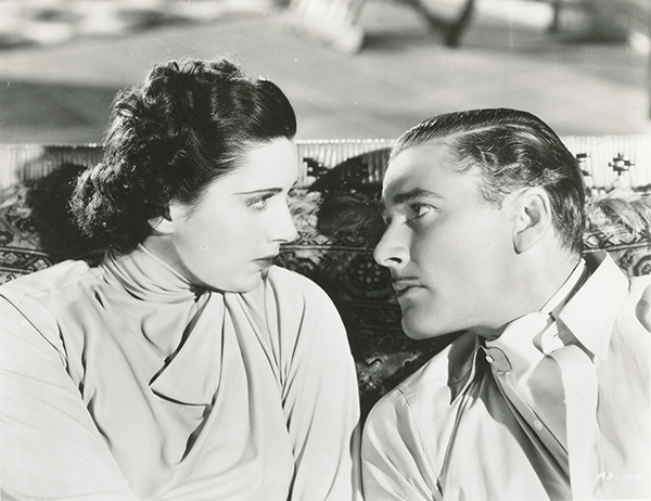 Kay Francis and Errol Flynn in Another Dawn (1937)