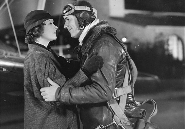 Myrna Loy bids farewell to William Gargan in Night Flight (1933).