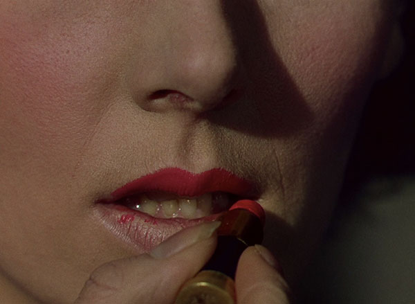 Kathleen Byron's fed-up nun applies bright red lipstick in Black Narcissus (1947)
